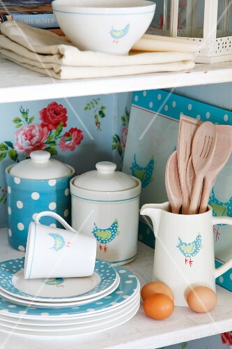 Blue and white patterned crockery on shelf