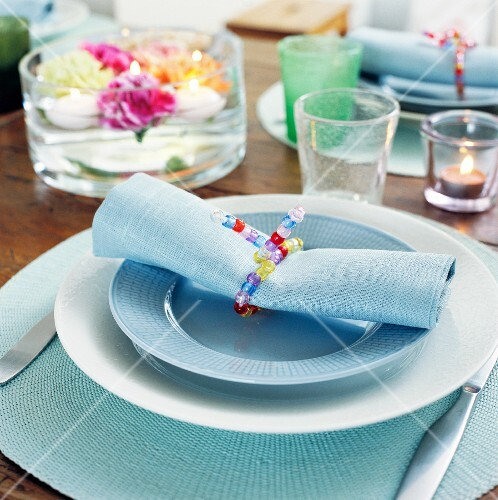 Place setting with a colourful beaded napkin ring