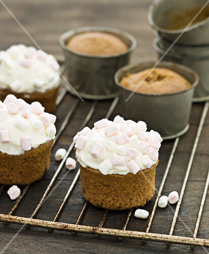 Pumpkin cupcakes topped with mini marshmallows