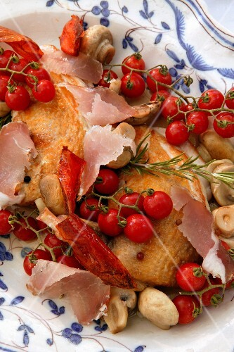 Duck with smoked ham and cherry tomatoes