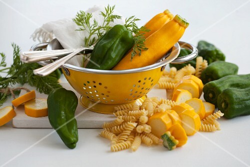 Yellow courgettes, green peppers and spiral pasta