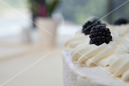 Fresh blackberries on a cream torte