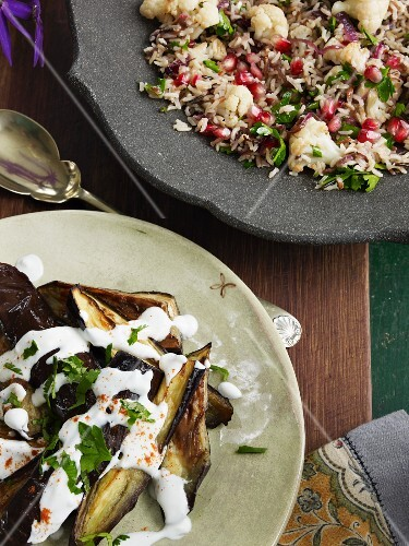 Rice salad with cauliflower and pomegranate seeds and grilled aubergines with yogurt
