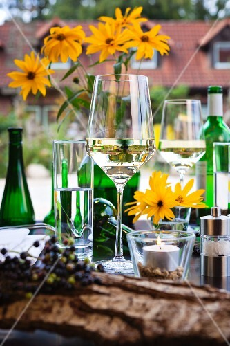 White wine glasses on a set table in front of a country home