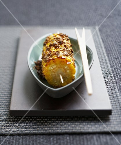 Grilled corn on the cob with an herb crust