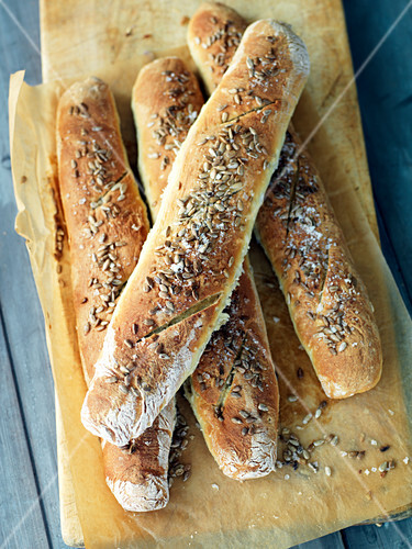 Four baguettes with sunflower seeds