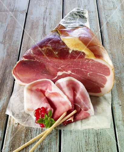 Cut, air-cured ham and grissini