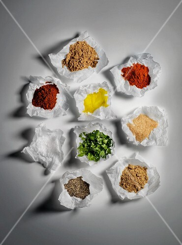 A variety of spices in parchment