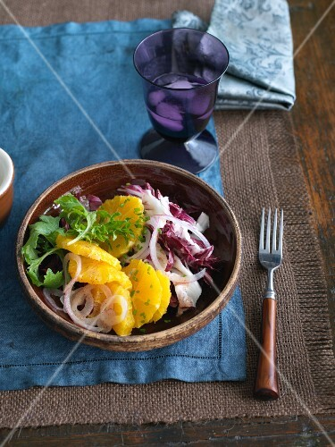 Orange and Red Onion Salad in a Bowl; Fork