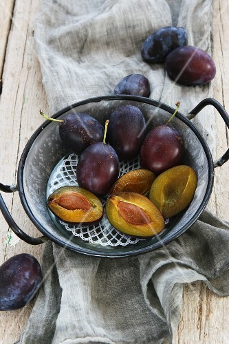 Plums in an old-fashioned enamel pot