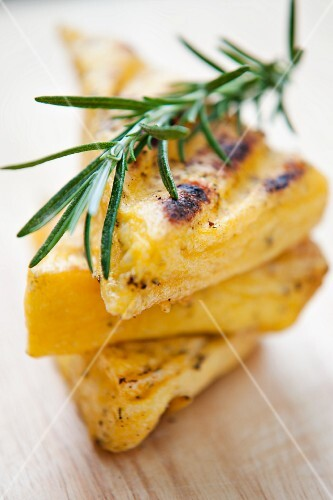 Grilled polenta slices with rosemary