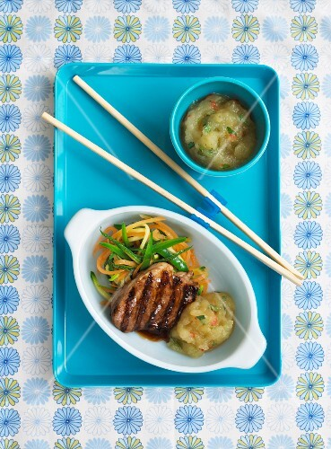 Grilled pork chop with apple sauce and vegetable strips