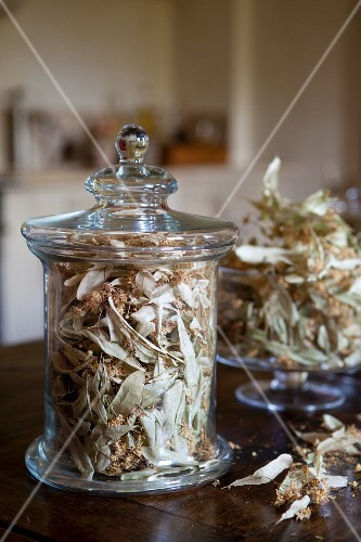 Dried lime leaves and blossom in storage jars
