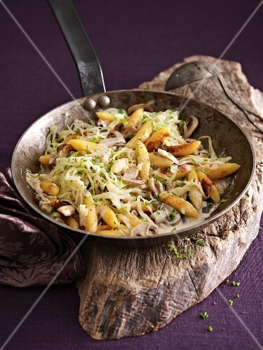 Potato orzo pasta with white cabbage and mushrooms