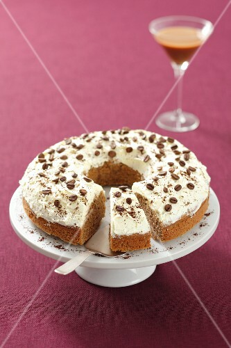 Coffee cake on cake stand, sliced