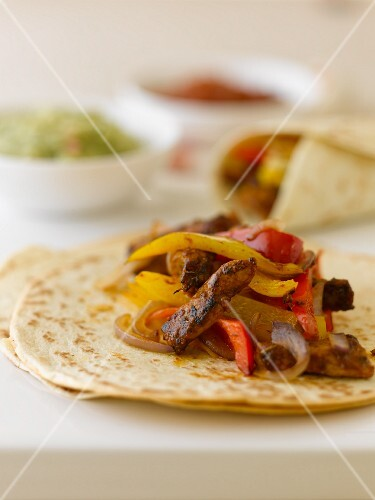 Fajitas with beef, peppers and onions (Mexico)
