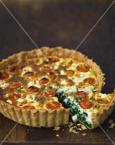 Tomato quiche with spinach, sliced
