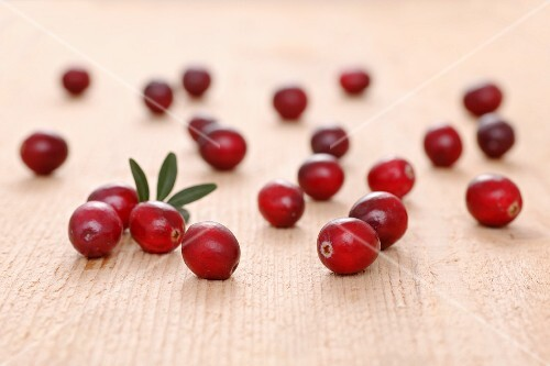 Fresh cranberries on a wooden surface