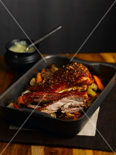 Crispy roasted pork belly in a roasting tin