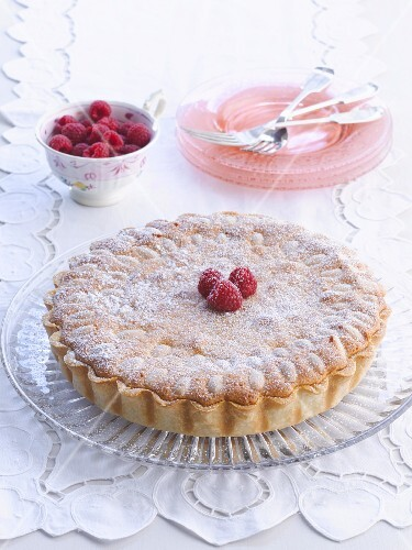 Raspberry tart with icing sugar