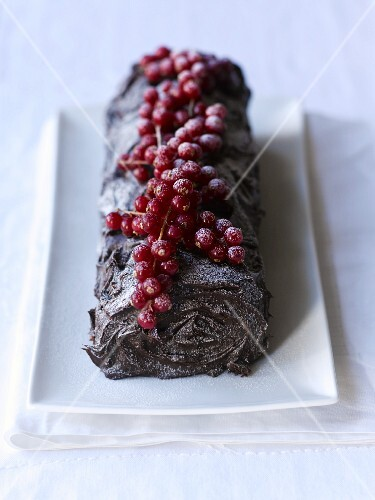 Yule log topped with redcurrants