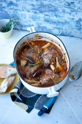 Braised lamb knuckle with artichokes and olives