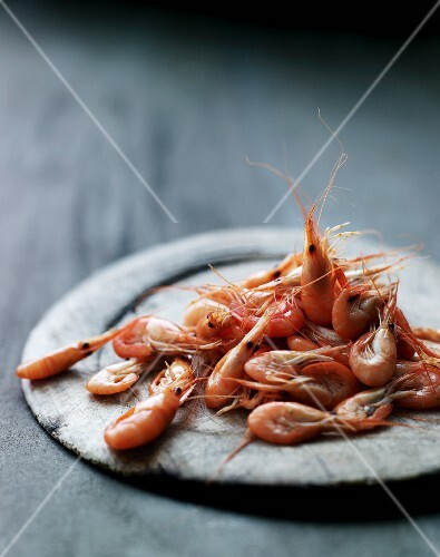 Prawns on a wooden plate