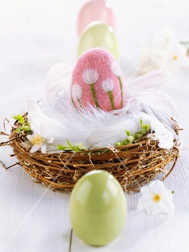 Felt Easter egg in Easter nest of feathers & twigs