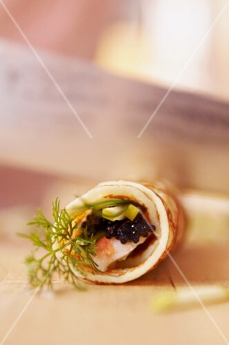 Pancake rolls filled with prawns and caviar