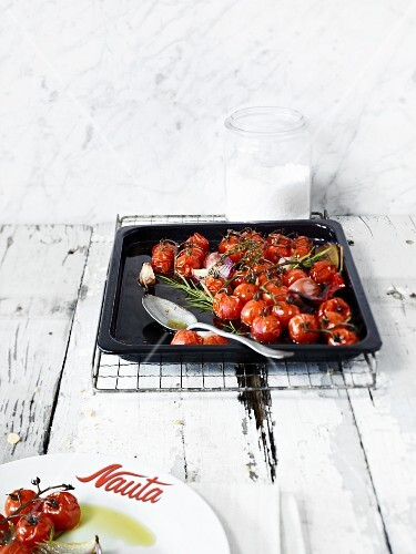 Braised cherry tomatoes on a baking tray