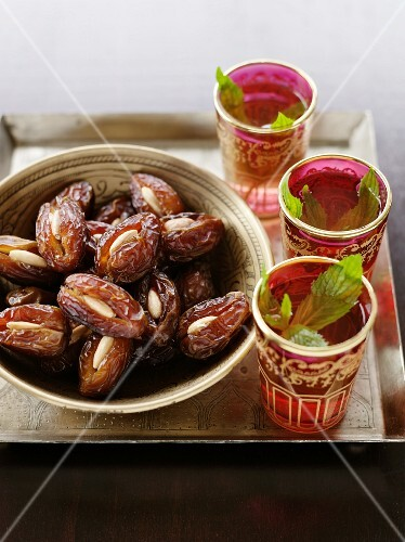 Mint tea and dates stuffed with almonds