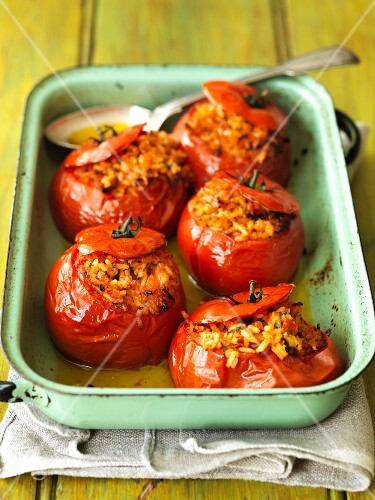 Stuffed tomatoes in an enamel baking dish