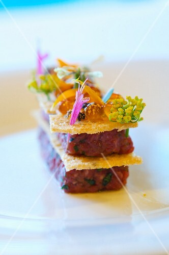 American Kobe Beef Tartare with Gilded Wild Salmon Roe, Basil Blossoms and Arugula Flowers