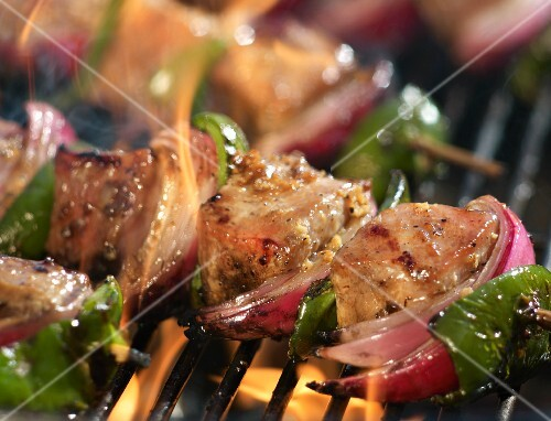 Pork, Red Onion and Green Pepper Skewers Cooking on the Grill