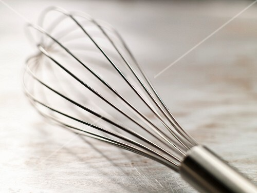 Metal Whisk on a Steel Surface