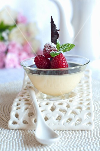 Bavarian cream with chocolate sauce and raspberries