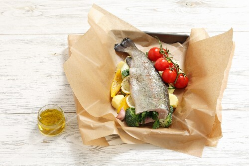 Stuffed trout with vegetables in foil (raw)