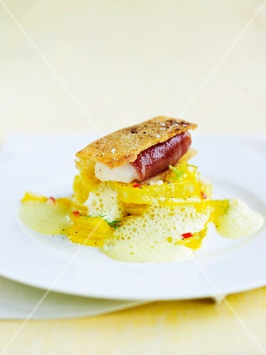 Fish confit wrapped in Parma toast on saffron fennel