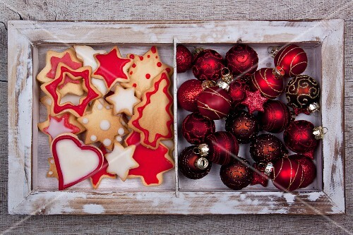 Christmas cookies and Christmas tree ball ornaments in a wooden frame