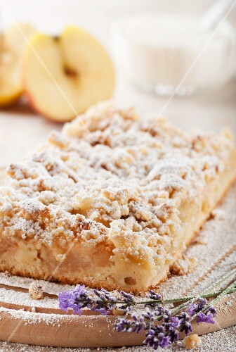 Apple crumble cake dusted with icing sugar