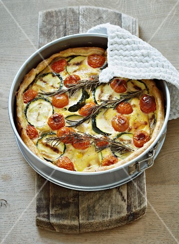 Mushroom quiche with courgettes, cherry tomatoes and rosemary