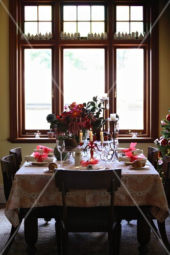 A table laid for Christmas dinner in front of a large window