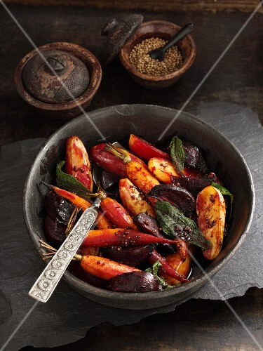 Oven-braised carrots, beetroot and potatoes