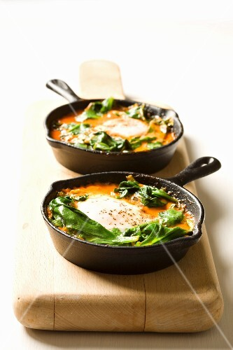 Shakshouka - poached eggs with tomatoes and spinach