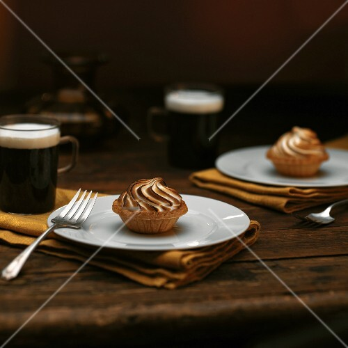Chocolate Caramel Tartlets with Toasted Meringue; On White Plates; Coffee