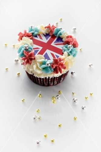 A cupcake topped with butter cream and a Union Jack