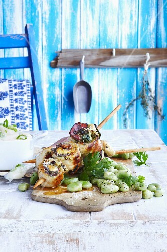 Chicken roulade kebab with pancetta, sage and broad beans