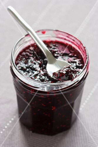 A jar of blackberry and raspberry jam