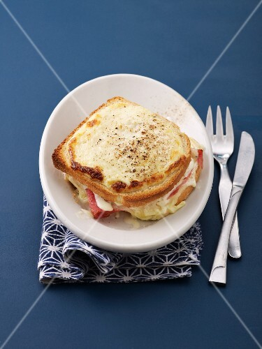 Croque Monsiseur (toasted cheese and ham sandwich) on a plate