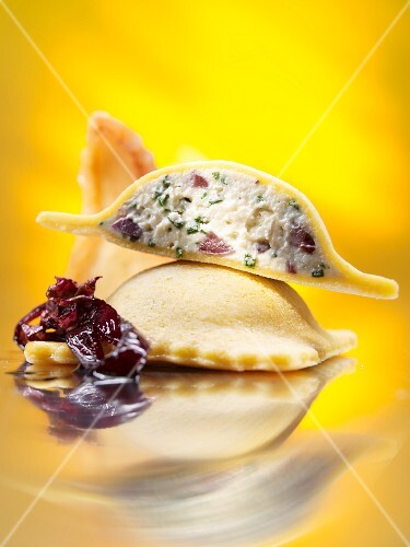 Cornflour ravioli filled with feta on braised radicchio with dried pears